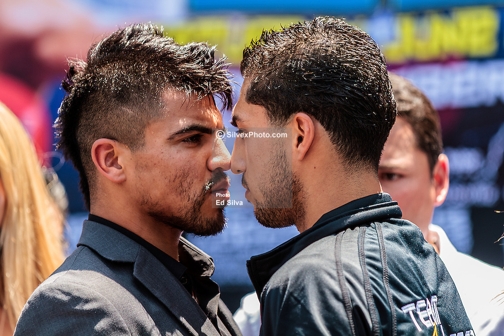 LOS ANGELES - JUNE 21: Former World Champion Victor 'Vicious' Ortiz (29-3-2,22 KO's) of Ventura, Calif (L) and Josesito Lopez (29-4, 17 KO's) face off  at the  Staples Center Press Conference in Los Angeles,CA. All fees must be ageed prior to publication, Byline and/or web usage link must read PHOTO © Eduardo E. Silva/SILVEX.PHOTOSHELTER.COM Failure to byline correctly will incur double the agreed fee.
