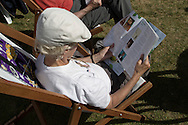 A woman with a programme of events in a deckchair on the first day of the Edinburgh International Book Festival. The three-week event is the world's biggest literary festival and is held during the annual Edinburgh Festival. The 2014 event featured talks and presentations by more than 500 authors from around the world and was the 31st edition of the festival.