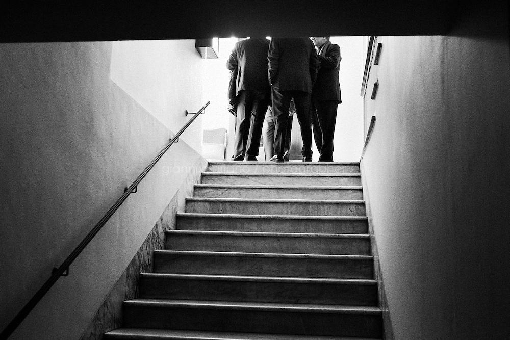 """ROME, ITALY - 24 JANUARY 2013: Denis Verdini, national coordinator of Silvio Berlusconi's People of Freedom party (PdL, popolo della Libertà), leads a meeting in a staircase of the Capranica Theatre during the PdL national convention in which Silvio Berlusconi, former PM and leader of The People of Freedom party, presents the PdL candidates for the upcoming general elections in Rome, on January 25, 2013. <br /> <br /> A general election to determine the 630 members of the Chamber of Deputies and the 315 elective members of the Senate, the two houses of the Italian parliament, will take place on 24–25 February 2013. The main candidates running for Prime Minister are Pierluigi Bersani (leader of the centre-left coalition """"Italy. Common Good""""), former PM Mario Monti (leader of the centrist coalition """"With Monti for Italy"""") and former PM Silvio Berlusconi (leader of the centre-right coalition).<br /> <br /> ###<br /> <br /> ROMA, ITALIA - 24 GENNAIO 2013: Denis Verdini, coordinatore nazionale del Popole della Libertà di Silvio Berlusconi, conduce una riunione in una scala della Teatro Capranica durante la convention nazionale del PdL in cui l'ex-premier e leader del Popolo della Libertà presenta i candidati PdL alle prossime elezioni politiche, a Roma il 24 gennaio 2013.<br /> <br /> Le elezioni politiche italiane del 2013 per il rinnovo dei due rami del Parlamento italiano – la Camera dei deputati e il Senato della Repubblica – si terranno domenica 24 e lunedì 25 febbraio 2013 a seguito dello scioglimento anticipato delle Camere avvenuto il 22 dicembre 2012, quattro mesi prima della conclusione naturale della XVI Legislatura. I principali candidate per la Presidenza del Consiglio sono Pierluigi Bersani (leader della coalizione di centro-sinistra """"Italia. Bene Comune""""), il premier uscente Mario Monti (leader della coalizione di centro """"Con Monti per l'Italia"""") e l'ex-premier Silvio Berlusconi (leader della coalizione di centro-destra).ROME, ITALY - 24 JANUARY 2013: Silv"""