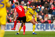 Sunderland forward Charlie Wyke (9) battles with Wimbledon defender Terell Thomas (6)  during the EFL Sky Bet League 1 match between Sunderland and AFC Wimbledon at the Stadium Of Light, Sunderland, England on 2 February 2019.