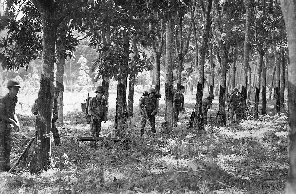 South Vietnamese army soldiers take up position in a rubber plantation as the North Vietnamese army made their advance on the city of Xuan Loc. Xuan Loc was the last major battle of the Vietnam War fought between 9th and 21st April 1975. Photographed by  Terry Fincher.