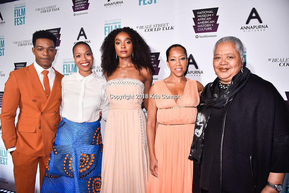 """WASHINGTON, DC - OCTOBER 27:   Stephan James, Dr. Rhea L. Combs, Curator of Film & Photography National Museum of African American History and Culture, Smithsonian, KiKi Layne, Regina Hall, and KInshasha Holman-Conwill, Deputy Director of the National Museum of African American History and Culture, speaks, attend  the closing night screening of """"IF BEALE STREET COULD TALK"""" at the inaugural Smithsonian African American Film Festival 2018 at National Air and Space Museum in Washington DC on October 27th, 2018. (Photo by Kris Connor/Annapurna Pictures)"""
