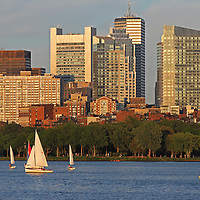 Boston skyline photography showing iconic Boston skyscrapers. The foreground is made off building reflections and Charles River sailboats sailing along. <br /> <br /> Boston skyline photos are available as museum quality photography prints, canvas prints, acrylic prints or metal prints. Fine art prints may be framed and matted to the individual liking and decorating needs:<br />  <br /> http://juergen-roth.pixels.com/featured/boston-charles-river-sailing-juergen-roth.html<br /> <br /> All photos of Boston are available for digital photography image licensing at www.RothGalleries.com. Please contact me direct with any questions or request.<br /> <br /> Good light and happy photo making!<br /> <br /> My best,<br /> <br /> Juergen<br /> Licensing: http://www.rothgalleries.com<br /> Photo Prints: http://juergen-roth.pixels.com<br /> Photo Blog: http://whereintheworldisjuergen.blogspot.com<br /> Instagram: https://www.instagram.com/rothgalleries<br /> Twitter: https://twitter.com/naturefineart<br /> Facebook: https://www.facebook.com/naturefineart
