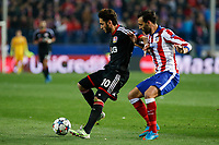 Atletico de Madrid´s Jesus Gamez (R) and Bayer 04 Leverkusen´s Calhanoglu during the UEFA Champions League round of 16 second leg match between Atletico de Madrid and Bayer 04 Leverkusen at Vicente Calderon stadium in Madrid, Spain. March 17, 2015. (ALTERPHOTOS/Victor Blanco)