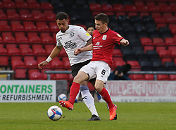 Jonson Clarke-Harris of Peterborough United in action with Tom Lowery of Crewe Alexandra - Mandatory by-line: Joe Dent/JMP - 14/11/2020 - FOOTBALL - Alexandra Stadium - Crewe, England - Crewe Alexandra v Peterborough United - Sky Bet League One