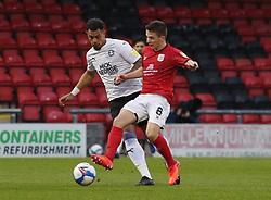 Jonson Clarke-Harris of Peterborough United in action with Tom Lowery of Crewe Alexandra - Mandatory by-line: Joe Dent/JMP - 14/11/2020 - FOOTBALL - Alexandra Stadium - Crewe, England - Crewe Alexandra v Peterborough United - Sky Bet League One