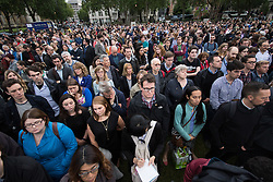 Parliament Square, Westminster, London, June 17th 2016. Following the murder of Jo Cox MP a vigil is held as friends and members of the public lay flowers, light candles and leave notes of condolence and love in Parliament Square, opposite the House of Commons. PICTURED: Part of the crowd that turned out in Parliament Square to remember Jo Cox.