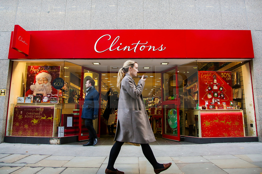 © Licensed to London News Pictures. 11/11/2019. London, UK.A woman walks past Clintons card store in City of London. Clintons are shutting down one in five of its stores with fears growing that the greeting card chain is on the brink of collapse, putting 2,500 jobs at risk. Photo credit: Dinendra Haria/LNP