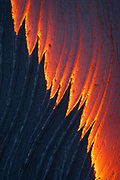 The trailing edge of a breakout's apex forms subtle lines on the surface of the river of molten lava, complementing the slowly extending textured crust.