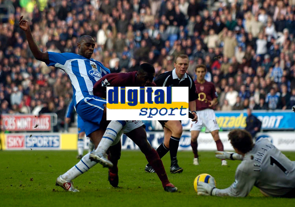 Photo: Jed Wee.<br />Wigan Athletic v Arsenal. The Barclays Premiership.<br />19/11/2005.<br />Wigan's Jason Roberts (L) is denied by defensive efforts from Arsenal's Kolo Toure (C) and goalkeeper Jens Lehmann as Wigan push for the equaliser.