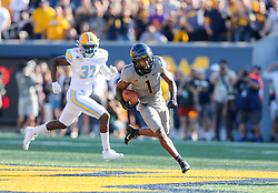 Sep 11, 2021; Morgantown, West Virginia, USA; West Virginia Mountaineers wide receiver Winston Wright Jr. (1) runs the opening kickoff back for a touchdown during the first quarter against the Long Island Sharks at Mountaineer Field at Milan Puskar Stadium. Mandatory Credit: Ben Queen-USA TODAY Sports