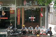 Workers in street during lunch break, Shanghai