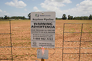 Douglas Texas, TransCanada waring sign for their Gulf Coast pipeline, which is the part of the southern route of the Keystone XL Pipeline. While President Obama holds off on his decision about the northern route of the Keystone XL , the southern route was built and put in operation . The Keystone XL pipeline is controversial because it will transport Canadian crude, also know as tar sands oil.
