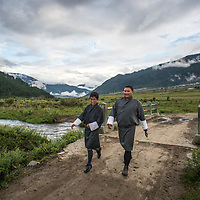Two Bhutanese men walking in the countryside<br /> <br /> Full photoessay at http://xpatmatt.com/photos/bhutan-photos/