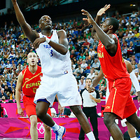 08 August 2012: France Ali Traore goes for the skyhook over Serge Ibaka during 66-59 Team Spain victory over Team France, during the men's basketball quarter-finals, at the 02 Arena, in London, Great Britain.
