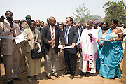 May0016089 . Daily Telegraph..Features.. The British Ambassador to Rwanda Nick Cannon with  local dignitaries at the opening ceremony for the Ngwino Nawe (Come To Us) Children's Village built by Rwanda Aid a British charity and recipient of funds from the Daily Telegraph's 2005 Christmas appeal..Built in Ntendezi in south west Rwanda, the village acts as both home and school for orphans, some victims of the 1994 genocide, and the mentally and physically handicapped...Rwanda 28 August 2009