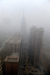 Heavy fog shrouds Zhengzhou City, capital of central China's Henan Province, Jan. 16, 2013. Affected by a cold front, the haze which has lingered in most parts of Henan for the past two weeks will begin to disperse on Jan. 17, 2013, according to the meteorological authority, China, January 16, 2013. Photo by Imago / i-Images...UK ONLY