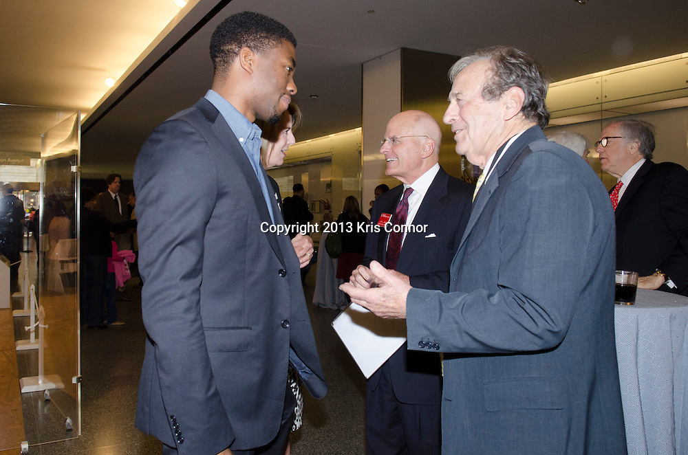 """WASHINGTON, DC - APRIL 15:  Chadwick Boseman and Carol Melton, Executive Vice President for Global Public Policy of Time Warner Inc, speak with John Gray, Director of the Smithsonian Museum of American History, during  the Washington DC screening of Warner Bro's film """"42"""" at Smithsonian Museum of American History on April 15th, 2013. Guests included star of the film Chadwick Boseman, John Gray, Carol Melton, and Lonnie Bunch. Photo by Kris Connor/Warner Bros"""