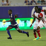 ORLANDO, FL - JUNE 18:  Kevin Molino #18 of Orlando City SC runs through two defenders during an MLS soccer match between the San Jose Earthquakes and the Orlando City SC at Camping World Stadium on June 18, 2016 in Orlando, Florida. (Photo by Alex Menendez/Getty Images) *** Local Caption *** Kevin Molino