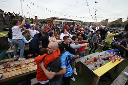 © Licensed to London News Pictures. 29/06/2021. London, UK. England fans react to going 1-0 up during the Euro 2020 round of 16 game between England and Germany at the Skylight Rooftop bar in Tobacco Dock, east London. Photo credit: Ben Cawthra/LNP