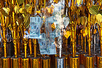 Tone Poh are an essential feature of every Buddhist ceremony in Laos. The trees are  embellished with cash at special Buddhist ceremonies and presented to monks.