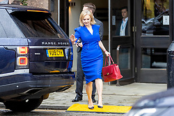 © Licensed to London News Pictures. 05/10/2021. Manchester, UK. Foreign Secretary Liz Truss slips on a plastic ramp as she leaves the Midland hotel this morning on the third day of the Conservative Party Conference in Manchester. Photo credit: Andrew McCaren/LNP