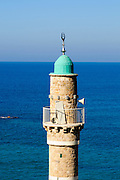 Israel, Tel Aviv - Jaffa, The turret of the El Baher mosque in old Jaffa the Mediterranean sea in the background