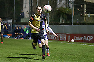 Marine defender Anthony Miley (5) chases the ball during the The FA Cup match between Marine and Havant & Waterlooville FC at Marine Travel Arena, Great Crosby, United Kingdom on 29 November 2020.