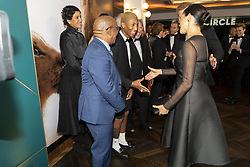 The Duke and Duchess of Sussex greet Pharrell WIlliams at the European Premiere of Disney's The Lion King at the Odeon Leicester Square, London.