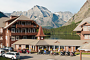 "Many Glacier Hotel was built in 1915 on the shore of Swiftcurrent Lake, Glacier National Park, Montana, USA. Since 1932, Canada and USA have shared Waterton-Glacier International Peace Park, which UNESCO declared a World Heritage Site (1995) containing two Biosphere Reserves (1976). Rocks in the park are primarily sedimentary layers deposited in shallow seas over 1.6 billion to 800 million years ago. During the tectonic formation of the Rocky Mountains 170 million years ago, the Lewis Overthrust displaced these old rocks over newer Cretaceous age rocks. Glaciers carved spectacular U-shaped valleys and pyramidal peaks as recently as the Last Glacial Maximum (the last ""Ice Age"" 25,000 to 13,000 years ago). Of the 150 glaciers existing in the mid 1800s, only 25 active glaciers remain in the park as of 2010, and all may disappear by 2020, say climate scientists."