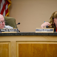 City manager Laura Jaramillo, right, and councilor Edwin Eli Dickens talks with other council members during a city council meeting Monday in Grants.