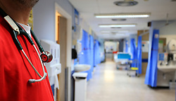 File photo dated 03/10/14 of a nurse on a ward at a hospital. Key aspects of person-centred care in English hospitals are showing signs of decline for the first time in years, according to a wide-ranging survey of NHS patients.