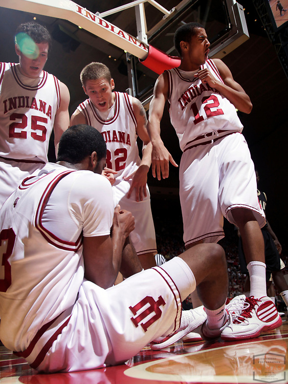 28 December 2009:Indiana forward Tom Pritchard (25), and teammates Derek Elston (32), and guard Verdell Jones III (12) react after Indiana guard Maurice Creek (3) is down with and injured left knee as the Indiana Hoosiers played the Bryant in a college basketball game in Bloomington, Ind.