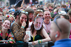 A festivalgoer wearing a Jeremy Corbyn mask as the crowd wait for Lorde to perform on The Other Stage at the Glastonbury Festival, at Worthy Farm in Somerset.