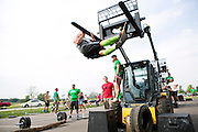 People compete in a CrossFit competition in Waunakee, Wisconsin on August 25, 2012.