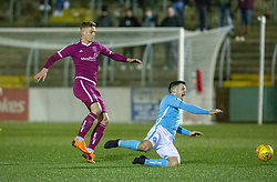 Arbroath's Thomas O'Brien tackles Forfar Athletic's Hilson for his second yellow card and is sent off. Forfar Athletic 2 v 3 Arbroath, Scottish Football League Division One played 8/12/2018 at Forfar Athletic's home ground, Station Park, Forfar.