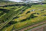 Nederland, Zuid-Holland, Zoetermeer, 23-05-2011; .Golfterrein Burggolflangs de A12 in Zoetermeer. Boven in beeld kassen. Golf  course along the motorway, greenhouses (top)..luchtfoto (toeslag), aerial photo (additional fee required).copyright foto/photo Siebe Swart