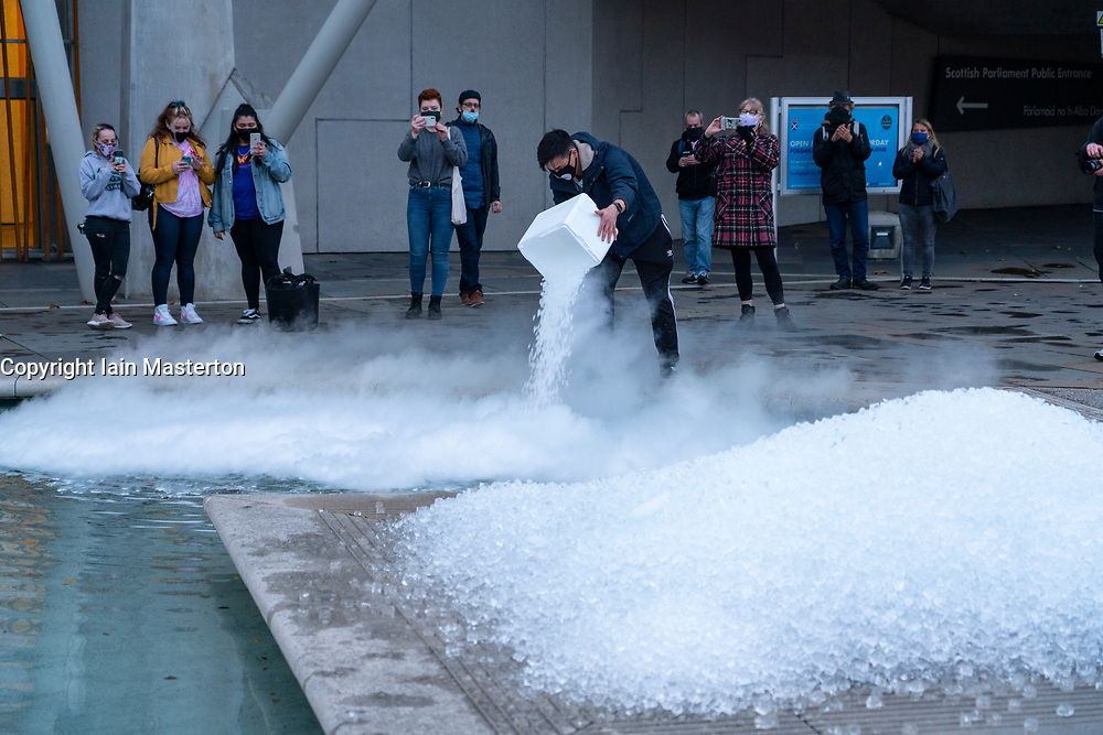 Edinburgh, Scotland, UK. ( October 2020. Bar owners in Edinburgh dumped sacks of ice in front of the Scottish Parliament building at Holyrood this evening in protest at the Scottish Government's rule that all pubs and bars in Lothian , including Edinburgh, must close at 6pm tonight for 16 days. Owners insist the rule is confused and inappropriate and is pushing many pubs out of business. Iain Masterton/Alamy Live News