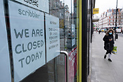 Closed Scribbler shop at Holborn as people wear face masks as the national coronavirus lockdown three continues on 5th March 2021 in London, United Kingdom. With the roadmap for coming out of the lockdown has been laid out, this nationwide lockdown continues to advise all citizens to follow the message to stay at home, protect the NHS and save lives, and the streets of the capital are quiet and empty of normal numbers of people.