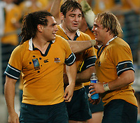 Photo: Steve Holland.<br />New Zealand v Australia. Semi-Final, at the Telstra Stadium, Sydney. RWC 2003. 15/11/2003. <br />Australian backrow, George Smith David Lyons and Phil Waugh celebrate at the end of the match.