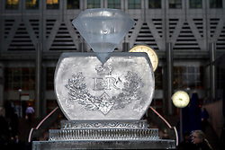 © Licensed to London News Pictures. 12/01/2012. London, UK. Ice Sculptor Asanga Amerasinghe has created a giant Jubilee diamond from ice in Canary Wharf's Reuters Plaza to celebrate the Queen's diamond jubilee this year in advance of The London Ice Sculpting Festival which begins tomorrow (13/01). Photo credit : James Gourley/LNP