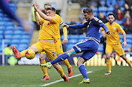 Cardiff City's Anthony Pilkington (blue) shoots at goal as Preston's Jordan Hugill tries to block the shot. Skybet football league championship match, Cardiff city v Preston NE at the Cardiff city stadium in Cardiff, South Wales on Saturday 27th Feb 2016.<br /> pic by Carl Robertson, Andrew Orchard sports photography.