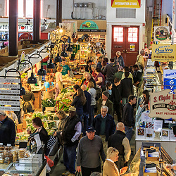 Customers shop for fresh products in Lancaster Central Market.