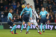 Jay Fulton of Swansea city gets to the ball ahead of  Matt Phillips of West Bromwich Albion. Premier league match, West Bromwich Albion v Swansea city at the Hawthorns stadium in West Bromwich, Midlands on Wednesday 14th December 2016. pic by Andrew Orchard, Andrew Orchard sports photography.