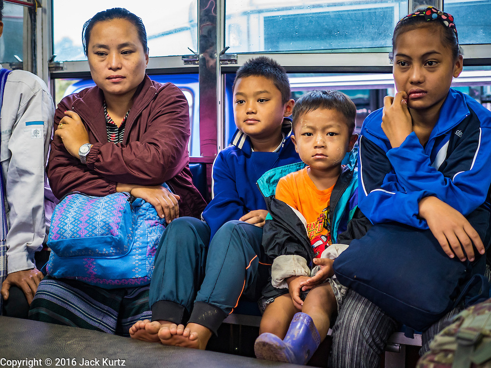 26 OCTOBER 2016 - NUPO TEMPORARY SHELTER, MAE CHAN, TAK, THAILAND: Burmese refugees on a bus in the Nupo Temporary Shelter refugee camp wait to leave the camp and be repatriated to Burma. Sixtyfive Burmese refugees living in the Nupo Temporary Shelter refugee camp in Tak Province of Thailand were voluntarily repatriated to Myanmar. About 11,000 people live in the camp. The repatriation was the first large scale repatriation of Myanmar refugees living in Thailand. Government officials on both sides of the Thai / Myanmar border said the repatriation was made possible by recent democratic reforms in Myanmar. There are approximately 150,000 Burmese refugees living in camps along the Thai / Myanmar border. The Thai government has expressed interest several times in the last two years in starting the process of repatriating the refugees.     PHOTO BY JACK KURTZ