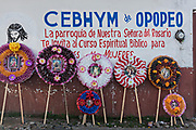 Colorful memorial wreaths on sale for the Day of the Dead festival along a street in Opopeo, Michoacan, Mexico.