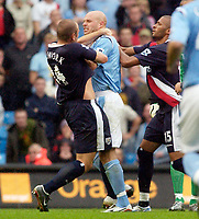 Photo: Daniel Hambury.<br /> Manchester City v West Bromich Albion. Barclaycard Premiership. 13/08/2005.<br /> Manchester City's Danny Mills and West Brom's Ronnie Wallwork get involved in a fight near the end of the game, both players were booked.