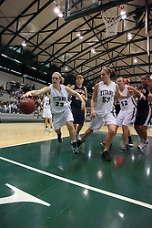 10 January 2009: Kylie Castans reaches for a rebound that is bounding to the out of bounds line. The Lady Titans of Illinois Wesleyan University downed the and Lady Thunder of Wheaton College by a score of 101 - 57 in the Shirk Center on the Illinois Wesleyan Campus in Bloomington Illinois.
