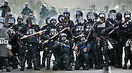 City of Miami Police prepare to repel against demonstrators protesting the Free Trade Area of the Americas meeting in Miami on October 20, 2003.