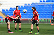 Joe Allen (r) of Wales in action during the Wales football team training at the Cardiff City Stadium in Cardiff, South Wales on Wed 23rd March 2016. The team are preparing for their forthcoming friendly against Northern Ireland.<br /> pic by  Andrew Orchard, Andrew Orchard sports photography.